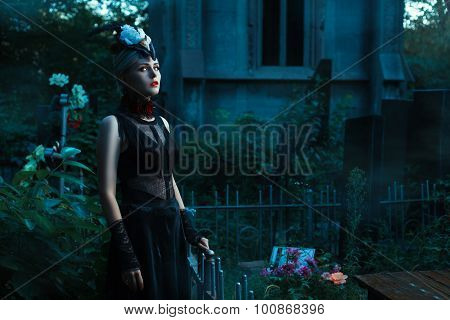 Woman With White Eyes Standing In A Cemetery At Night.