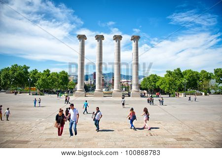 BARCELONA, SPAIN - MAY 02: Tourists Gathered Around Les Quatres Columnes, The Four Columns, a Major Tourist Attraction Located in Barcelona, Spain. May 02, 2015.