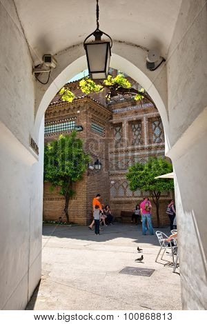 BARCELONA, SPAIN - MAY 02: View Through Arched Passage Way with Hanging Lantern in Historic Poble Espanyol Museum Area, Barcelona, Catalonia, Spain. May 02, 2015.