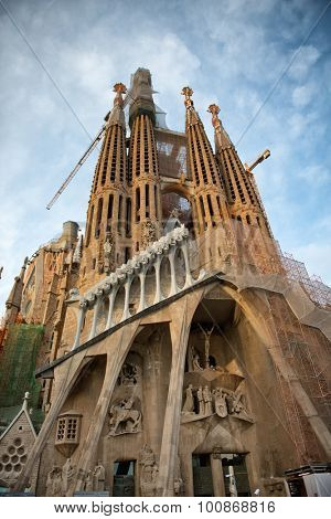 BARCELONA, SPAIN - MAY 02: Exterior facade looking up from below at the ornate Gothic spires of the Sagrada Familia, Barcelona, Spain desighned by Antoni Gaudi. May 02, 2015.