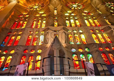 BARCELONA, SPAIN - MAY 02: Architectural Interior View of Sagrada Familia Church in Barcelona, Spain - Looking Up at Colorful Stained Glass Glowing in Exterior Sunlight. May 02, 2015.