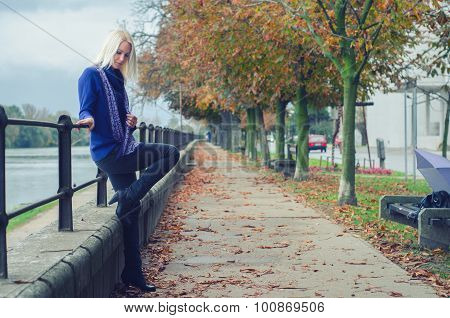 Beautiful Young Woman Outdoor On Rainy Autumn Day
