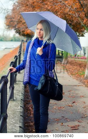 Beautiful Young Woman With Umbrella On Rainy Autumn Day