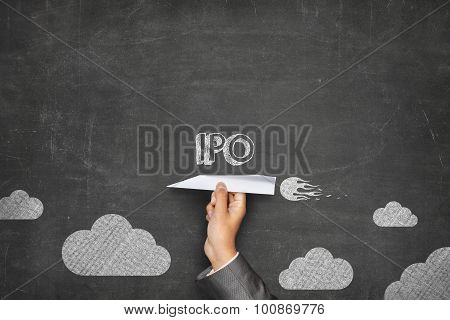 IPO concept on blackboard with paper plane