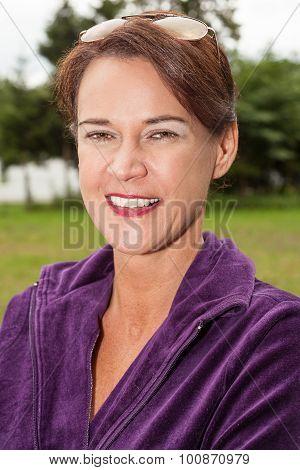 Brunette Woman Wearing Purple Top Outdoors
