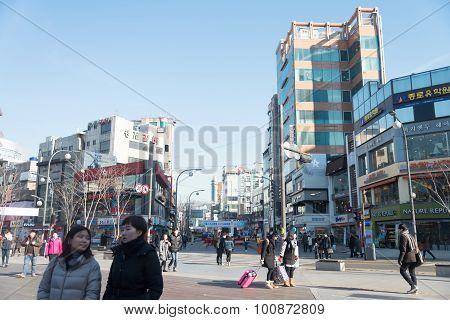 People Cross Street At Urban Area In South Korea