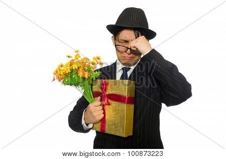Gentleman with gift box and flowers isolated on white
