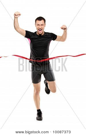 Full Length Portrait Of A Young Runner At The Finish Line
