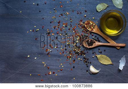 Wooden Spoons With Condiment And Garlic And Olive Oil