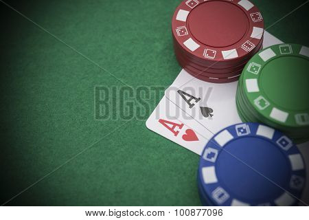 Two Ace Of Pokers Beside Lots Of Chips On Casino Table