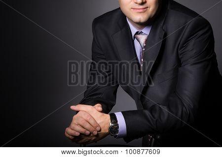 Elegant man wearing fashion suit. Businessman in formal wear
