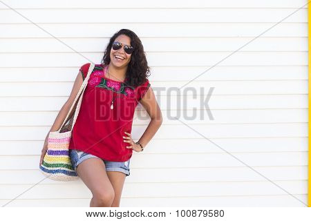 Young latin female traveler wearing handmade Mexican clothing. Isla Mujeres, Cancun, Mexico.