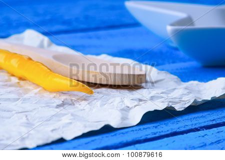 Kitchenware and hot chili pepper on a sheet of paper