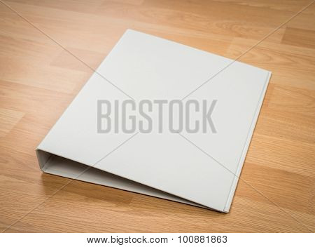 White  folder on wood