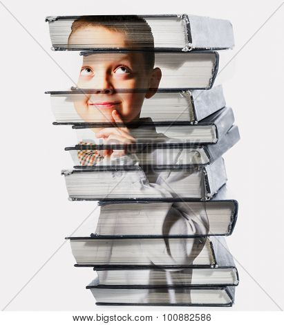 thinking school boy mixed with pile of books, isolated on white background