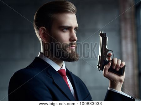 Danger man with gun looking aside portrait.