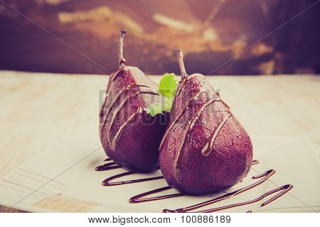 Vintage Photo Of Pears Cooked In Red Wine With Chocolate