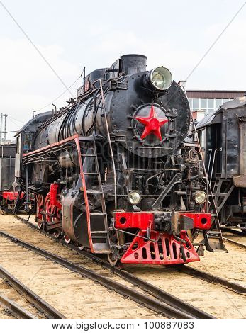 old black steam locomotive in Russia