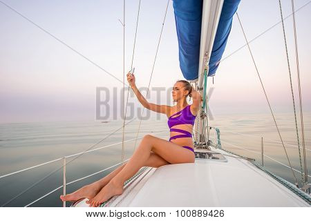 Girl makes selfie on the yacht.