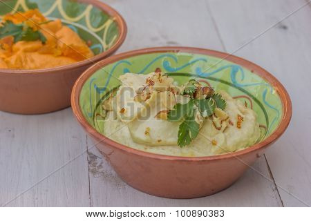 White Humus On A Wooden Table