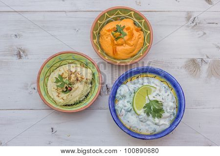 Humus And Tzatziki On A Wooden Table