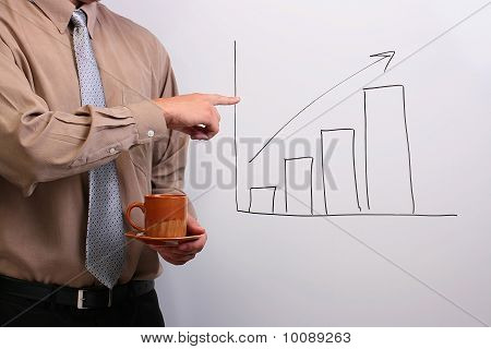 Man Pointing To A Drawing