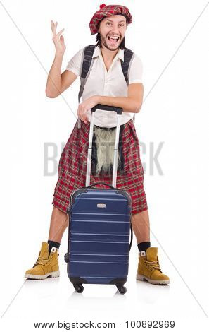 Scotsman with suitcase isolated on white