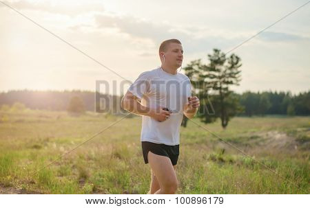 Jogging Outdoors In The Woods