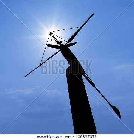 Silhouette Of Wind Turbine For Renewable Energy On Beautiful Sky Background