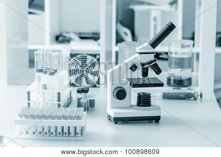 monocular microscope on blue background