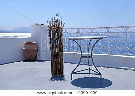 Beautiful White Terrace Overlooking Sea In Oia, Santorini, Cyclades, Greece