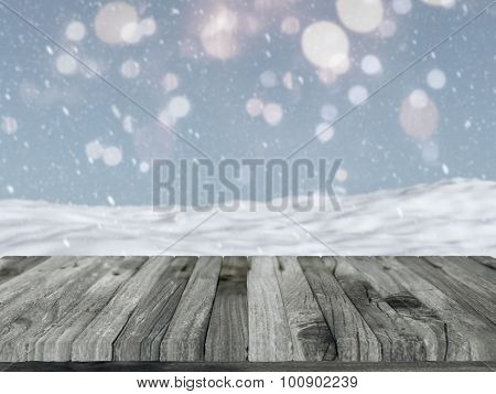 3D render of a wooden table with a defocussed snowy landscape in the background