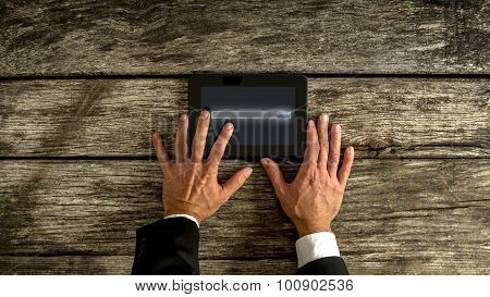 Businessman Hand Holding Tablet On The Table
