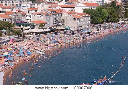 PETROVAC, MONTENEGRO - JULY 08: crowded main beach of Petrovac Na Moru. The town is found in the sandy bay, encircled with the thick pine forests. Shot in 2015