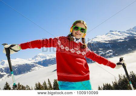 Ski, winter vacation, snow, skier, sun and fun - girl enjoying ski vacation