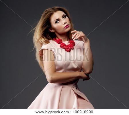 Fashionable Blonde Lady Posing In Studio.