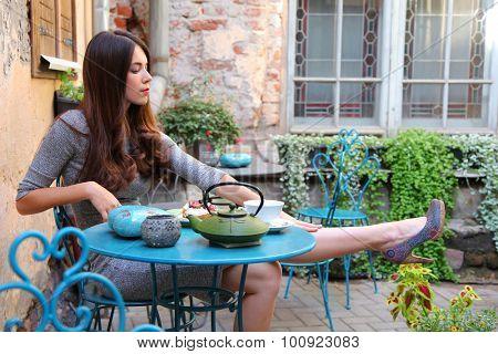 beautiful young woman relaxing in cute cafe