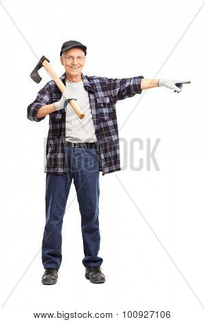 Full length portrait of a senior man holding an axe on his shoulder and pointing isolated on white background