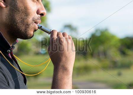 Blowing whistle