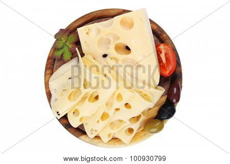 yellow swiss cheese sliced on wooden platter with olives and tomato isolated over white background