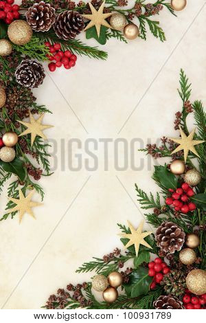 Christmas abstract background border with gold bauble decorations, holly,  fir and cedar cypress greenery.