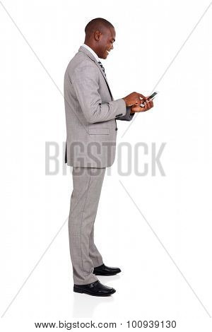 side view of afro american businessman using smart phone