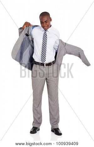 young african american businessman putting on suit jacket isolated on white