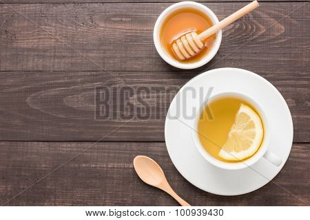 Tea With Lemon And Honey On The Wooden Background