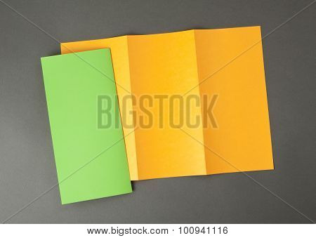 Blank Orange And Green Folding Paper Flyer