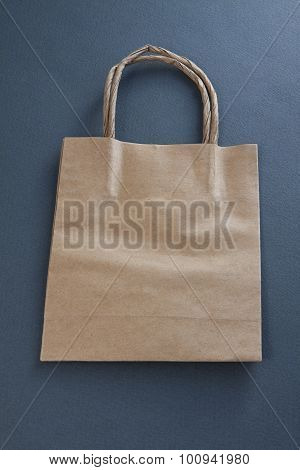 Recycled Paper Shopping Bag On Gray Background