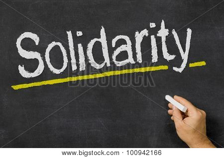 Solidarity Written On A Blackboard