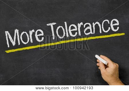 More Tolerance Written On A Blackboard