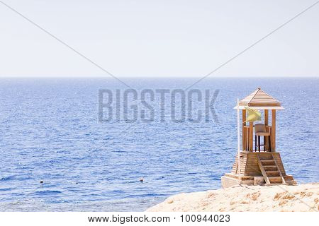 Sea Or Ocean View From Shore With Lifeguard Post