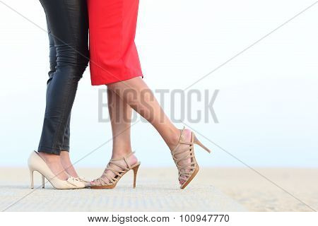 Couple Of Lesbian Women Legs Cuddling With Love